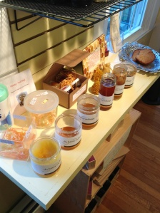 An assortment of honey to taste!  Check out all of the different colors - a result of the bees and what type of flower or plant they took nectar from!